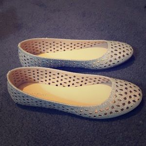 Glittery flats with holes